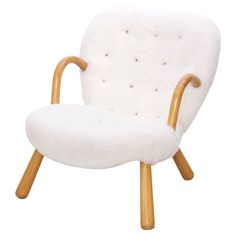 Clam Chair by Philip Arctander | From a unique collection of antique and modern lounge chairs at https://www.1stdibs.com/furniture/seating/lounge-chairs/
