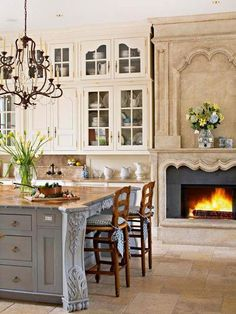 The fireplace in this French Country kitchen is fantastic.