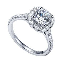 A cushion diamond halo perfectly frames your center ring in this white gold engagement ring. Prong set diamond flow down the band and at carat total weight this ring is a beautiful way to express your devotion. Three Stone Engagement Rings, Halo Diamond Engagement Ring, Halo Rings, Cushion Cut Halo, Dream Ring, White Gold Diamonds, Wedding Rings, Classic White, Bridal Style