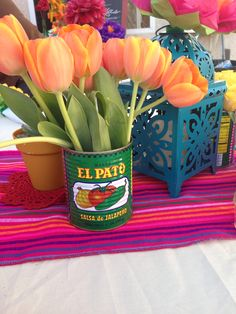 40th birthday Mexican Fiesta Party- Like the idea of using the food cans (from prepping the food) to put flowers in