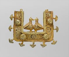 Earrings and Pendant | The Met  11th–12th century  Geography:Attributed to Iran  Gold; filigree and granulation