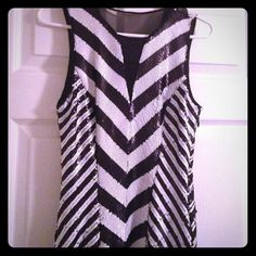 Black and white Bebe Dress Only wore 1X,  Can be worn back or front depending on amount of cleavage you want to show. bebe Dresses