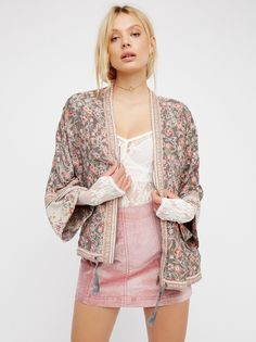 Wildflower Printed Kimono | Lightweight colorful printed kimono-style jacket featuring a front zip closure. Drawstring closure at the waist with hip pockets.