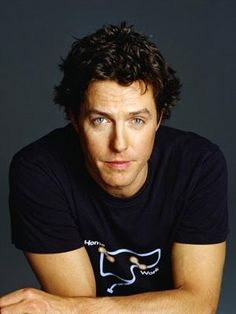 Hugh Grant...yes Im aware of the hooker story....but he makes me laugh, his accent is sexy, and everytime I watch him kiss someone in a movie, my knees get weak. Some things you just cant explain.