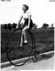 A woman riding a classic penny farthing bicycle, Toronto, c. 1930. #vintage #Canada #1930s #bikes
