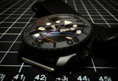 Something #Sinister lurking... version 2.Ohhhh! #Seiko #SKX007 #SKXenhanced with smoke super dome #sapphire, graphite black #Cerakote, BT bezel, #ceramic bezel insert, coated BT M/H hands, red tipped S, #hacking #handwinding #automatic movement, one of th