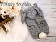 Soft, warm, and cute! This fulffy bunny eared hoodie is a great addition to your babys wardrobe. Made out of minky fur fabric the inner lining will keep your baby nice and toasty. The outer shell is made of grey knit fabric and has a beautiful diamond quilt-like detail weaved in.