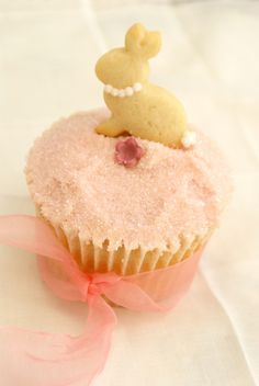Oh my goodness!  It's a bunny in pearls cookie on top of this simple little pink cupcake.  That is just too cute!