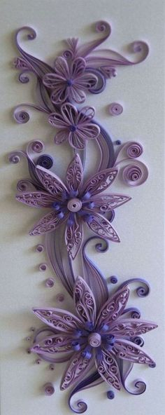 inspiration only - upcycling - toilet paper roll - amazing wall art - beautiful purple and blue flowers