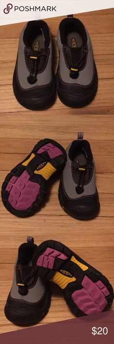 Size 11 kids Keene. Excellent condition. Thick rubber sole with good traction. Black and grey with pink stitching and yellow accents. Keen Shoes Water Shoes