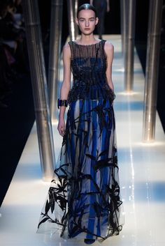 bamboo stalks and leave embellishments on the sheer over-skirt with royal blue vertical striped under-skirt Armani Privé Spring 2015 Couture - Collection - Gallery - Style.com