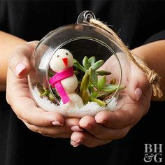 Embrace a nature-inspired look with terrarium Christmas ornaments. To create, simply add faux snow to your succulent terrarium and pop in a pom-pom snowman. To make, simply glue three white pom-poms together and add felt details. Finish by using marker to create eyes.