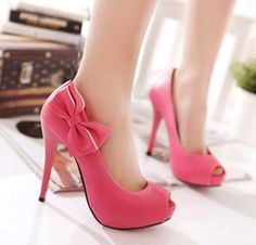 Elegant pink high heels with bow