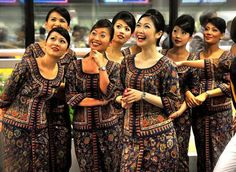 Singapore Girl ( Singapore Airlines cabin crew)