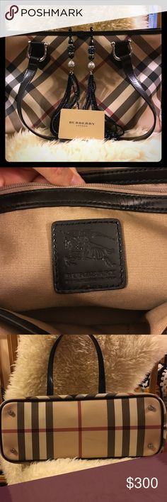 Authentic Burberry Prorsum Nova Check Tote. Authentic Burberry Prorsum Collection.  Excellent condition, rated 8/10.  Slight bubbling in only one corner as shown in photo.  Metal pegs on the bottom keeps your bag from sitting directly on a surface, one zippered interior pocket and two open.  Serial # CNPANSIM1PAN.  Clean, smoke-free home!  See additional post for photos of bag being worn. Burberry Bags Totes