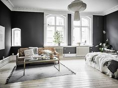 Living space with grey hues and a statement chandelier