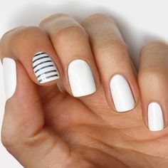 Simple white manicure with a striped statement nail