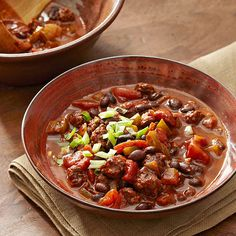 """Beef and Black Bean Chili: """"Start planning your next chili night! This slow cooker chili recipe can be prepped in just 25 minutes, then add everything to the slow cooker and come home to a healthy dinner loaded with veggies and 8 grams of fiber."""""""