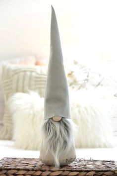This beautiful neutral color gnome will melt your heart! Will look great in any home, would make an amazing gift, and just might be that one holiday decoration that youll keep out around all year! • • • This listing is for one (1) LARGE size Scandinavian Gnome with a stone (greyish beige) cotton poplin body and light solid grey felt hat. His beard is soft, frosted grey faux fur. He is about 17 inches tall. Gnome is filled with fiberfill and a bean bag to make him sturdy. So glad youve found…