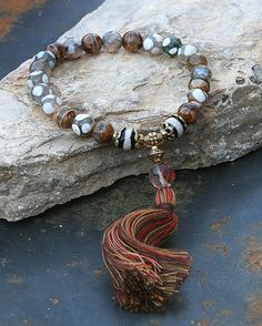 Wrist mala bracelet made from 21, 8 mm - 0.315 inch, faceted and smooth agate gemstones and decorated with a faceted cherry quartz stone - look4treasures on Etsy