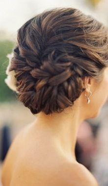 Looks like a fishtail braid swept around into a bun. Leave some soft, loose pieces around your face