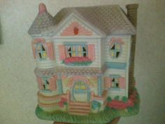 Cottontail Lane Lighted Victorian House. Midwest Importers of Cannon Falls, Inc