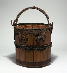 iron-bound yew-wood bucket, found at Sutton-Hoo (more details at http://www.britishmuseum.org/research/search_the_collection_database/search_object_details.aspx?objectid=91603=1)