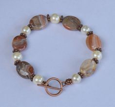 Red Persian Gulf Agate Flat Oval Gemstone and Vintage Imitation Pearl Beaded Bracelet with Antique Copper Toggle Clasp.  8.0 inch bracelet.