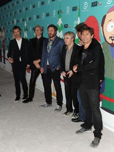 """Nick Rhodes Photos Photos - (L-R) Writer/creator of South Park Matt Stone, musicians Jon Taylor, Simon Le Bon and Nick Rhodes of Duran Duran, writer/creator of South Park Trey Parker, and Roger Taylor of the musical group Duran Duran arrive at """"South Park's"""" 15th Anniversary Party at The Barker Hanger on September 20, 2011 in Santa Monica, California. - """"South Park's"""" 15th Anniversary Party - Arrivals"""