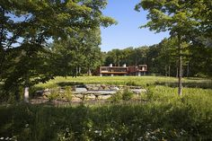 Joeb Moore: New England Design Hall of Fame 2016. David Sundberg frequently collaborates with architect Joeb Moore. David's photographs of Moore's Bridge House are included in the awards issue of New England Home Magazine. The house is very much part of the landscape. Documenting season changes involved two trips to the site for snow scenes first, and then summer views too.