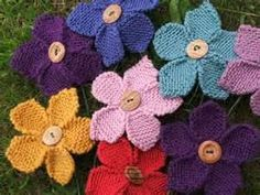 colorful little knitted flowers