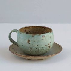 I like the simplicity of this. it looks lightweight and the curve at the bottom invites it perfectly into this saucer. Also I like the slight angle inward of the top half of the cup.Japanese Stoneware Cup and Saucer / Turquoise and Natural Specks Pottery Mugs, Ceramic Pottery, Pottery Art, Thrown Pottery, Slab Pottery, Ceramic Tableware, Ceramic Clay, Ceramic Bowls, Japanese Ceramics