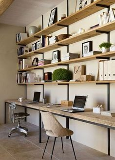 Floor to ceiling shelving  Love the wood shelves on brackets. Long desk. Office/ homework station
