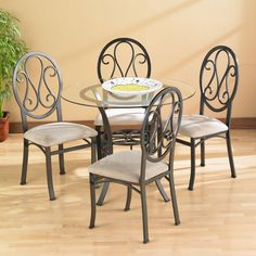<li>Add a modern flair to your home dining decor with this classically styled table set</li><li>Table and chairs feature classic scrolled iron</li><li>Dining furniture is finished with a powder coated dark chocolate color</li> Glass Dining Room Table, Dining Decor, Modern Dining Table, Best Dining, Dining Sets, Round Dining, Dining Rooms, Dining Area, In China