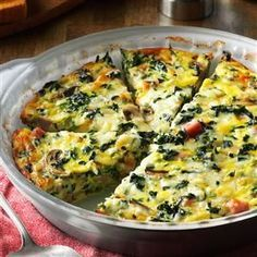"Crustless Spinach Quiche Recipe -I served this dish at a church luncheon and I had to laugh when one gentleman said to me, ""This is good, and I don't even like broccoli!"" I replied, ""Sir, it isn't broccoli. It's spinach."" He quickly answered, ""Oh, I don't like spinach, either, but this is good!"" —Melinda Calverley, Janesville, Wisconsin"