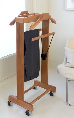 This fantastic Stuart Suit Valet Stand is designed and manufactured to the highest standard in Italy. A great hanging storage solution, with two hangers and trouser bars with trays for cufflinks, watch etc - all in lovely warm beech wood - on sturdy castors with a shoe storage shelf at the bottom. Everything a gentleman needs to facilitate an ordered start to the day!