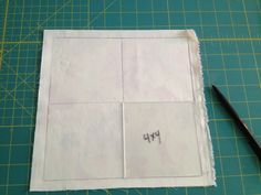 """Using a template like in the last shot another ruler you might have or a 4"""" (for a 3 inch finished or 5"""" for 4"""" finished) square, create an equal sided cross on your fabric."""