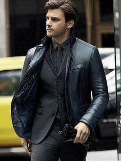 Johannes Huebl... leather blazer over suit