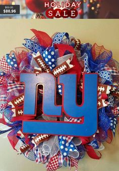 Custom Handmade Football deco mesh wreath with handpainted wooden team logo with small football. NFL NCAA, Pick your colors and logo. #etsy #handmadegifts #vineandwhimsy #giftguide2016 #etsygifts #shopsmall #blackfriday2016 #etsychaching #giftsgalore2016 #smallbizsat #epiconetsy