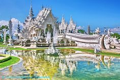 "Wat Rong Khun, ""The White Temple"", Chiang Rai, Thailand. Inside the temple, along with traditional Buddhist imagery, you will also find paintings of futuristic spaceships and pop culture images such as the Predator, Neo from Matrix, Spiderman, Batman, and creatures from Avatar.  http://www.thaiguidetothailand.com/thai-temple/wat-rong-khun-white-temple/"