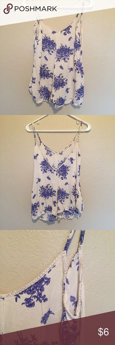 Floral Romper Blue and white floral romper. Slips on. Pants Jumpsuits & Rompers