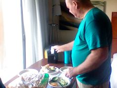 papa conehead making some dinner in Rockford, Illinois hotel room