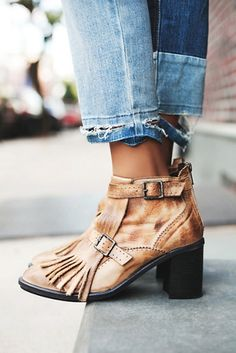 Circle Back Heel Boot | Free People Distressed leather ankle boot featuring a pointed toe with fringed tassel detailing.