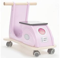 Childrens Wooden Toys - Designer Kids Toys - Classic retro multi directional ride on scooter by Jamm Toys - makes a fantastic first ride-on toy!  This retro wooden ride on scooter features authentic detailing - no complicated peddling involved on this stylish ride-on toy. Multi directional casters give free flowing movement in all directions for great indoor fun.  #woodenscooter #childrenswoodentoys #designerkids #ecofriendly #educationaltoys #littlebooteek