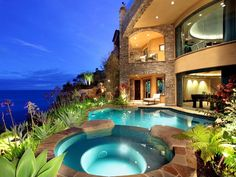 Mediterranean Hot Tub with Natural stone archway, Glass railing system, exterior stone floors, Inground pool, French doors
