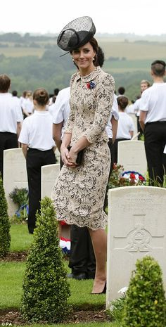 She matched her bespoke outfit with a floral brooch, which featured the commemorative flow...