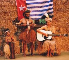 The Lani Singers are husband and wife, Benny and Maria Wenda, from the Baliem Valley in West Papua. They write/play songs about historic Lani Tribe rituals Modern Traditional, Traditional Outfits, West Papua, Cowboy Hats, Singers, Husband, Painting, Play, Shopping