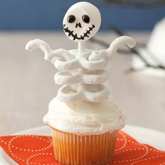 Halloween Skeleton cupcakes. Head is a marshmallow and body is yogurt-covered pretzels.