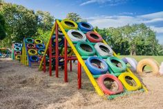 Photo about Playground built with old tires for children plays. Recycling old tires. Image of built, leaf, beautiful - Millions of Creative Stock Photos, Vectors, Videos and Music Files For Your Inspiration and Projects. Kids Outdoor Play, Outdoor Play Areas, Kids Play Area, Backyard For Kids, Tire Playground, Outdoor Playground, Playground Ideas, Tire Craft, Kids Yard