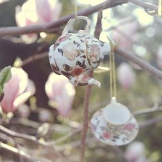 Hang whimsical little tea cups on branches- cute for a bridal shower or birthday party